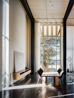 "Each line is in communication with every other line: ceiling lines align with glazing patterns, while in the dining room the windows open together, a reference to the idea of a ""machine for living."""