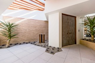The entrance sets the tone for the home's indoor/outdoor midcentury feel.