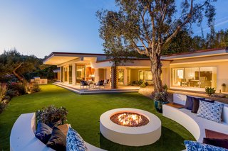 A backyard lounge area complete with a fire pit is perfect for al fresco entertaining.