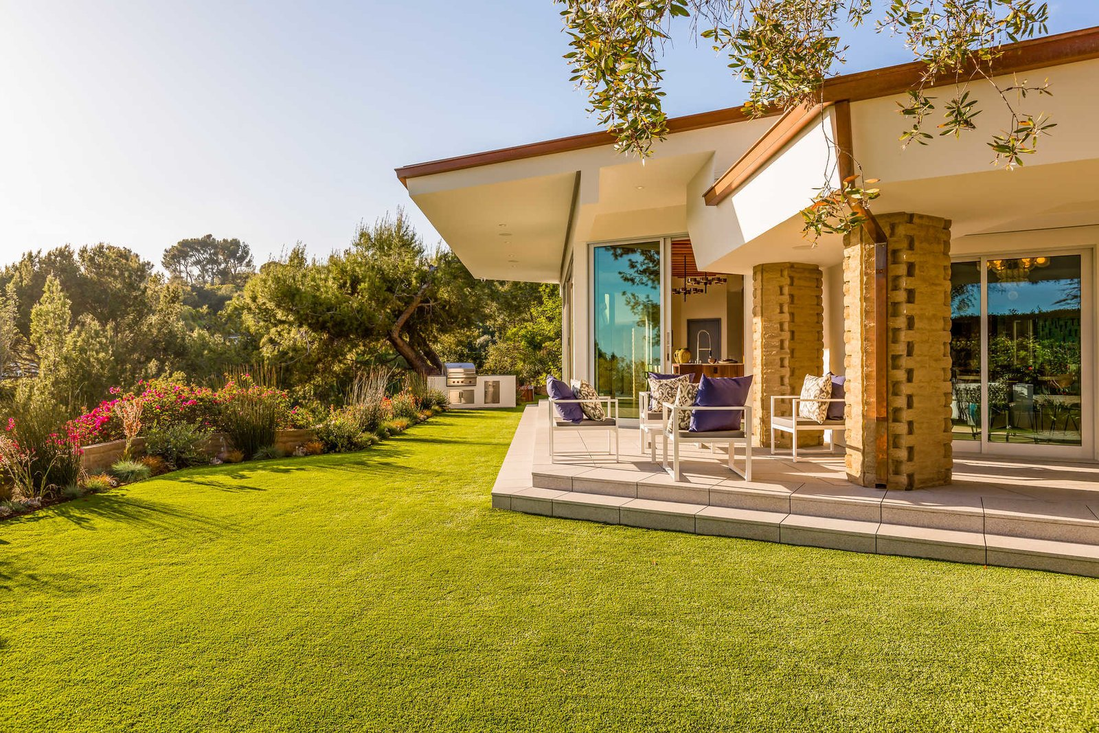Set on nearly 1.5 acres in lower Bel Air, the home features breathtaking views of the Pacific Ocean and the Getty Museum.