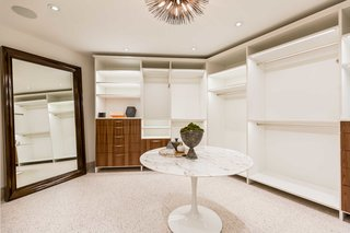 Two closets allow homeowners to claim personal storage space.