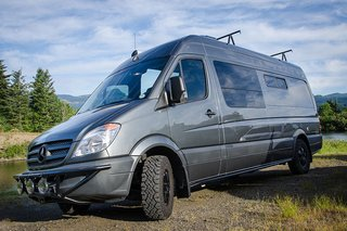 "This ""Space Mountain"" van is a converted Mercedes Sprinter 170."" It now features a mini kitchen, table, and dinette with benches that pull out to form a 74-inch bed."