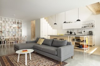 The open-plan living room, dining area, and kitchen are encompassed with bright vibes.