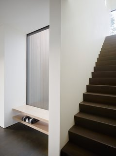 Stairs lead to the second-level master suite.