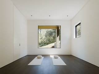 A tranquil nook allows the homeowner to practice yoga.