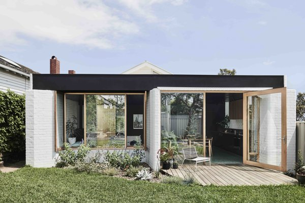 The architects were looking to create a space that would reflect the client's eclectic and playful sensibility, while also establishing a connection between the new living spaces and lush garden.