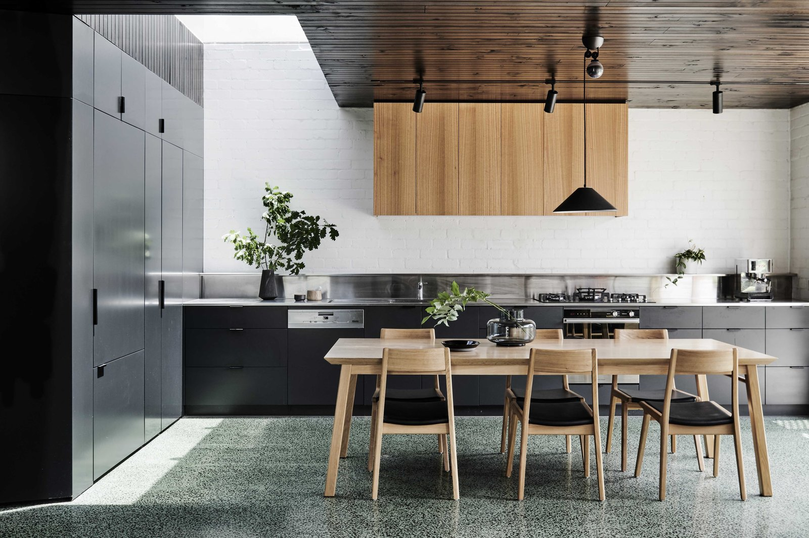 Kitchen, Ceiling, Range, Wall Oven, Range Hood, Terrazzo, Drop In, Brick, Refrigerator, and Pendant  Kitchen Range Hood Pendant Ceiling Drop In Photos