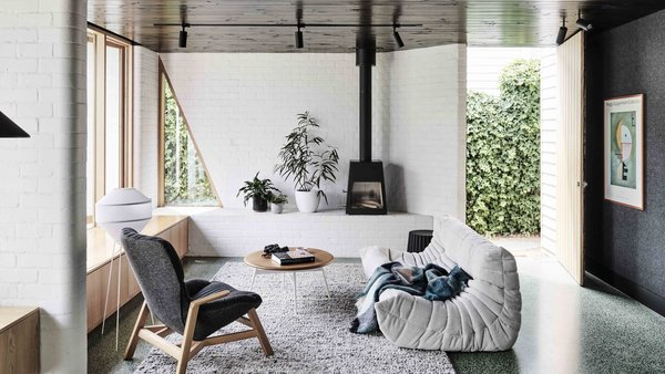The architects were looking to create a space that would reflect the client's eclectic and playful sensibility and to establish a connection between the new living spaces and the garden beyond.
