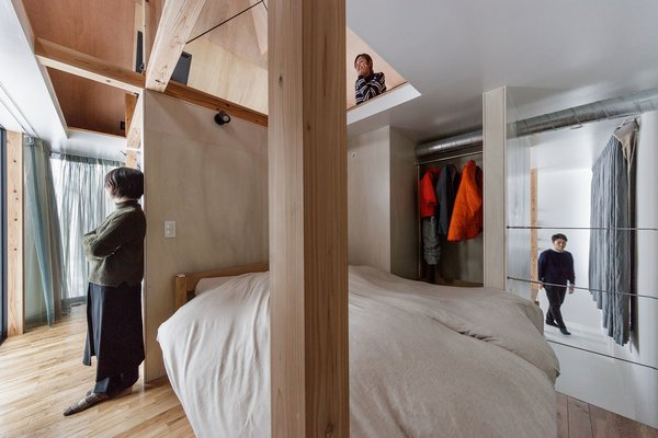 The upper level conceals the bedroom.