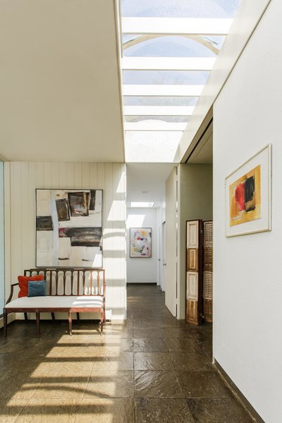 Sunlight streams through skylights and glass walls allowing homeowners to take full advantage of the architecture.