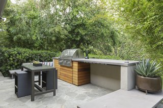 The barbecue area has easy kitchen access and features built-in seating for entertaining.
