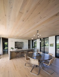 Oak floors and millwork throughout unify the spaces.