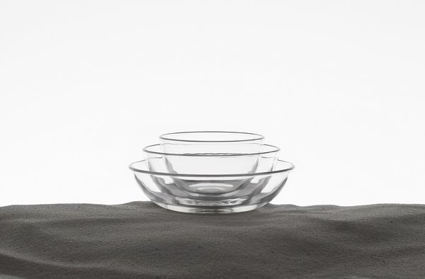 Taking the form of a landscaped garden, the series of vignettes displays a selection of MUJI's well-loved products composed with the raw materials used to produce them, encouraging visitors to discover the products' materialorigins. Here, MUJI's glassware emerges from a bed of sand, the main ingredient in glass.
