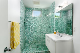 The master bath has a beautifully tiled walk-in shower.