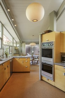 The updated kitchen maintains a midcentury feel.