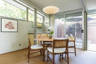 The dining area overlooks an outdoor patio.