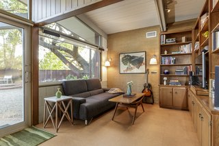 Anook off the living room provides a quiet spot for reading or watching television.