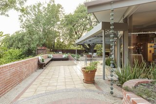 The lovely flow of the outdoor space encourages indoor/outdoor living and is a perfect complement to the interiors.
