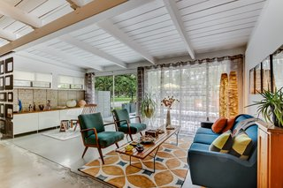 The soaring tongue-and-groove ceiling adds to the authentic midcentury charm.