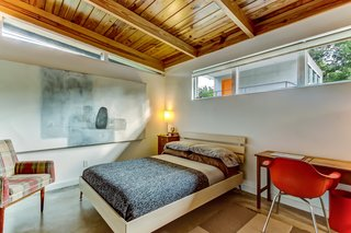The bedrooms feature original exposed wood ceilings and clerestory windows for additional natural lighting.