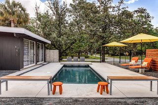 The outdoor pool deck has a brick hearth and is perfect for entertaining.