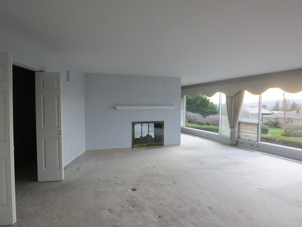 Prior to the renovation, the living room felt dark and dated.