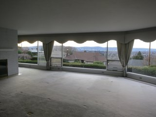 Before: The flat, low ceilings in the living areas severely compromised the views.