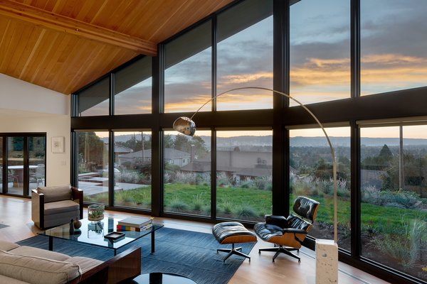 The vaulted ceiling adds an expansive airy feel that the original home lacked. Now, the wall of windows perfectly frames the gorgeous overlook.