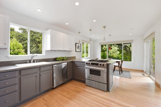 The adjacent dining nook features sliding doors that lead out to the patio and a breakfast bar.