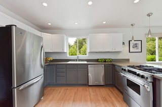 The kitchen has been conveniently modernized and features an open layout.