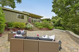 Stairs lead to the garden's lower level and a larger patio that is an ideal setting for entertaining.