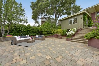 The landscaping has been given lots of love and includes Japanese maples, palm fronds, drought-tolerant grasses, and flowers.