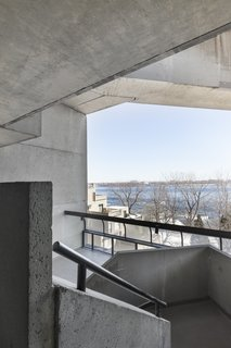 A view of the Saint-Laurence River and the concrete exterior of Habitat 67.