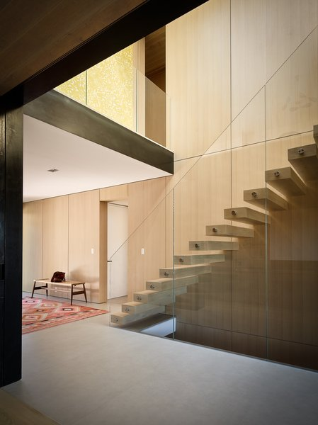 A grand staircase was transformed into a floating cantilevered structure, bringing natural light into the lower rooms.