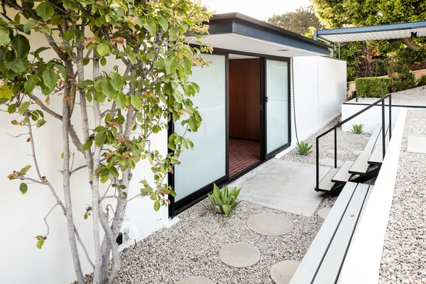 The structure is an updated showcase of midcentury modern architecture.