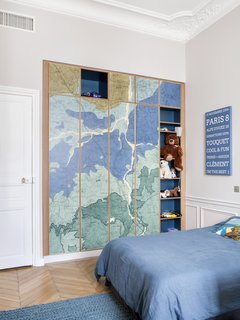 Oxford Clay by Rebel Walls has been placed on the wardrobe doors in one of the kids' rooms.