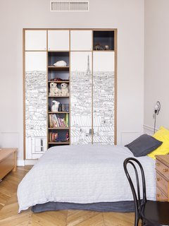 Oh My Wall Paris Wallpaper has been placed on wardrobe doors with the shelves painted off-black from Farrow & Ball.
