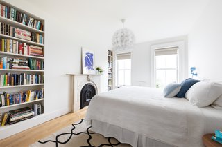 The spacious master bedroom has an original mantle, two built-in bookcases, and an enormous walk-in closet.