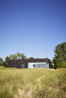 The exterior of the home is clad in charred wood siding, which pays homage to summertime bonfires on the beach.