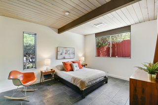 All of the bedrooms have a spacious, yet midcentury feel.