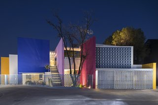 The brightly colored panels of the home even pop when viewed at night.
