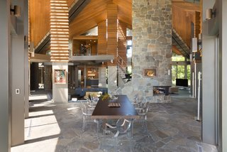 The open plan flows harmoniously within the cathedral-like canopy of glass and redwood.