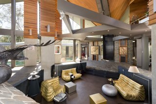 The dominate brutalist design is offset by ample glazing, making the interiors bright and airy.