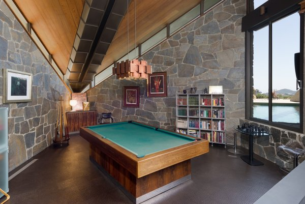 Chamberlain's custom-built pool-table remains in this corner of the house. <br>