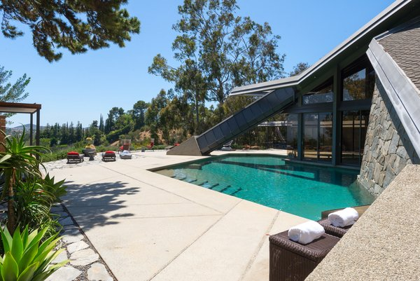 The gated residence sits on two and a half acres of land, overlooking the Bel Air Reservoir.