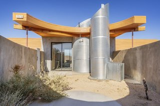 The cylinders of corrugated aluminum are incorporated into the exterior design as well.
