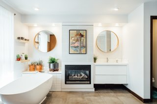 The master bath has a fireplace to keep things cozy.