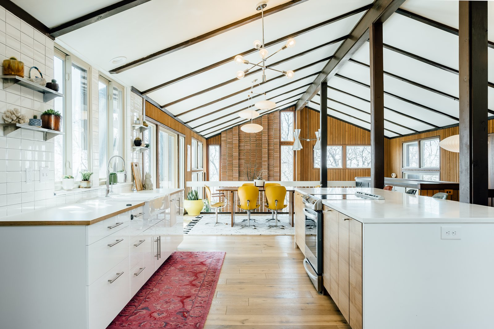 Kitchen, Pendant, Light Hardwood, Wood, Drop In, White, Rug, Porcelain Tile, Range, and Quartzite  Best Kitchen Light Hardwood Drop In Range Photos from A Midcentury Gem in Utah Is Listed For $550K