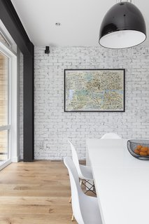 White walls serve as a gallery to display the owner's personal art collection.