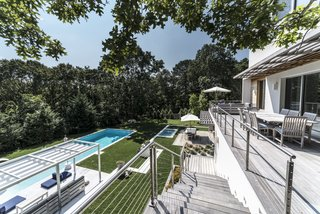 Thebackyard was terraced and the pool was redesigned. It went from a 14'x36' standard pool to a 18'x50' saltwater gunite structure with a hot tub terraced above it.